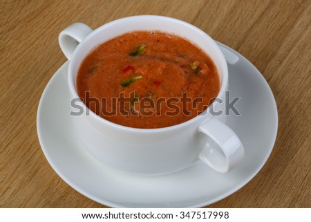 Traditional summer soup - Gazpacho on the wood backgroubd