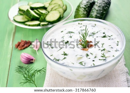 Traditional summer soup Tarator with cucumbers, dill and walnut - stock photo