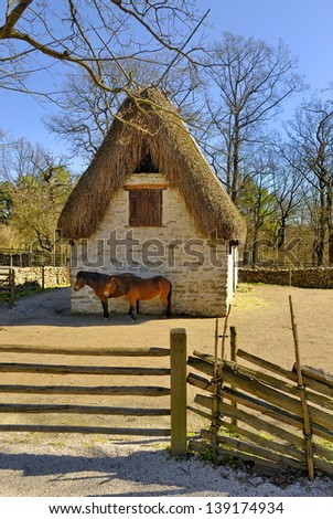 Traditional Swedish wooden hut, Skansen Stockholm, Horses in front of the stable, Sweden, Europe  - stock photo