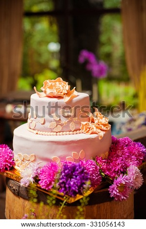 Traditional sweet. Wedding cake with flowers.