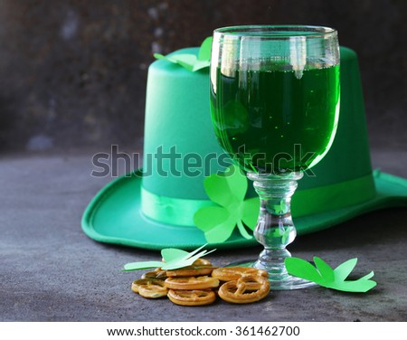 traditional symbols for Patrick's Day - green beer and clover - stock photo