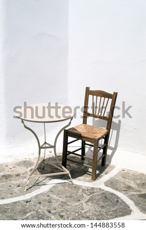 Traditional table and chair located on Mykonos island, Greece - stock photo