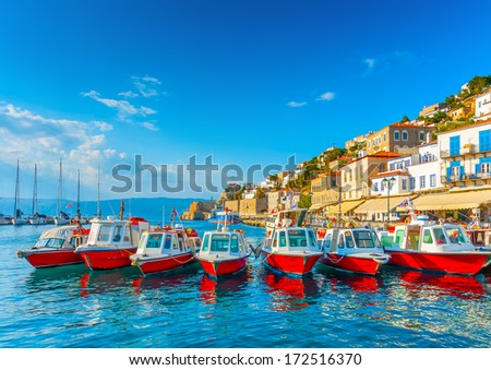 traditional taxi boats in the port of Hydra island in Greece - stock photo
