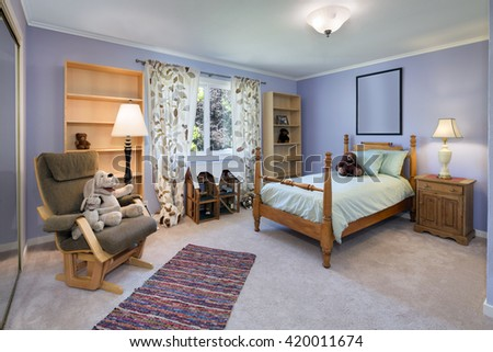 Traditional teenager room / child room / kids room with wooden furniture and toys.  - stock photo