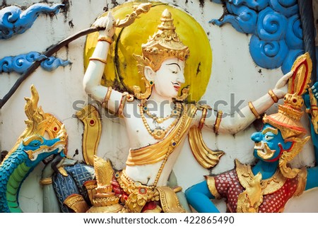 Traditional Thai a bas-relief with the image of good and evil in the temple - stock photo