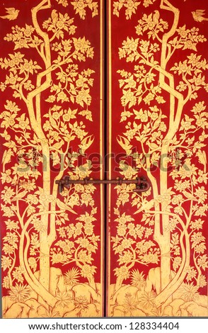 Traditional Thai art of painting on the door - stock photo