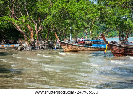 Traditional Thai boat, Long tail stand in the sea at Railay beach, Krabi, Thailand - stock photo