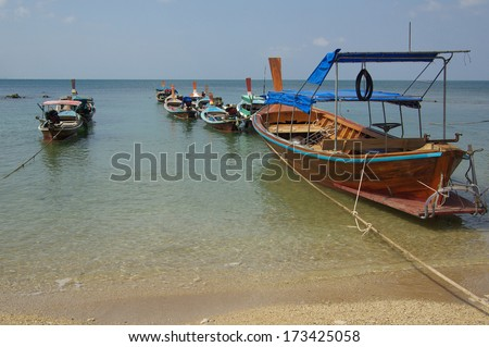 Traditional Thai boat on Ko Lanta beach, Krabi province, Thailand - stock photo