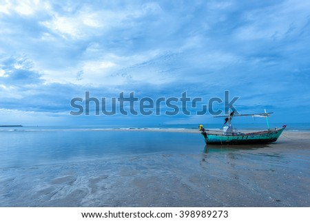 Traditional Thai boat or long tail boat stand at the beach