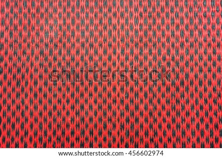 Traditional thai flax weaving, detail of a woven mat. - stock photo