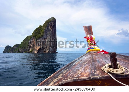 Traditional Thai long tail boat in the waters of Koh Phi Phi, Krabi Province, Thailand.  - stock photo