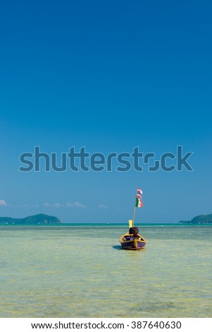 Traditional thai longtail boat at famous sunny Long Beach, Thailand, Koh Phi Phi Don, Krabi province, Andaman sea