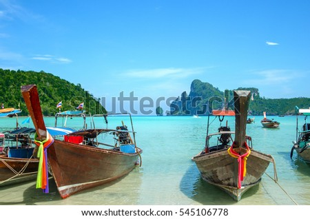 Traditional thai longtail boats at famous sunny Long Beach, Thailand, Koh Phi Phi Don, Krabi province, Andaman sea