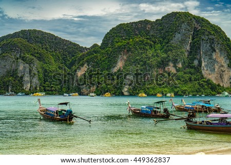 Traditional Thai Longtail boats on phi phi island , thailand ,
