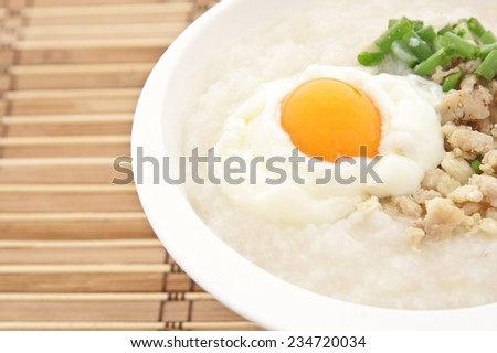 Traditional thai porridge rice gruel in white bowl, congee.