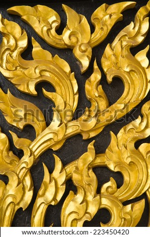 Traditional Thai style church door - stock photo