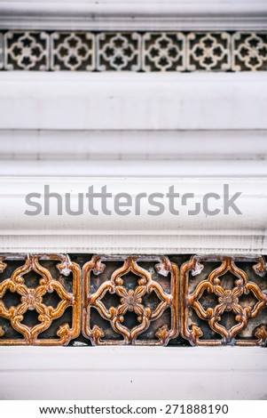 Traditional Thai style decoration of tile & stucco on the big pagoda in temple - stock photo