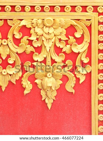 Traditional Thai style flower pattern decorative, stucco gold paint in temple,Thailand.