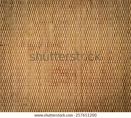 traditional thai style pattern nature background of decorative brown handicraft weave texture wicker surface for furniture material - stock photo