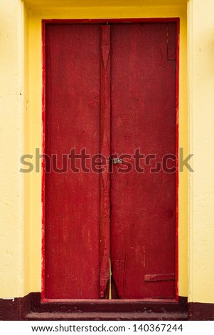 Traditional Thai style red door and window.