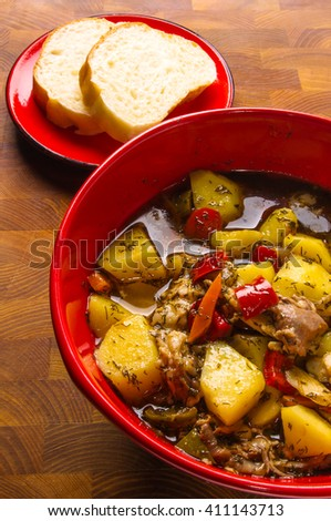 traditional thick meat soup with potatoes and vegetables