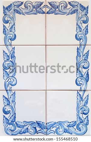 Traditional tiles (azulejos) from facade of old house in Porto, Portugal - stock photo