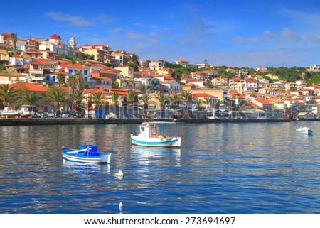 Traditional town and harbor of Koroni in sunny day of summer, Greece