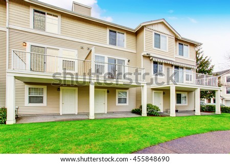 Traditional town house back yard with balcony. Concrete walkway - stock photo