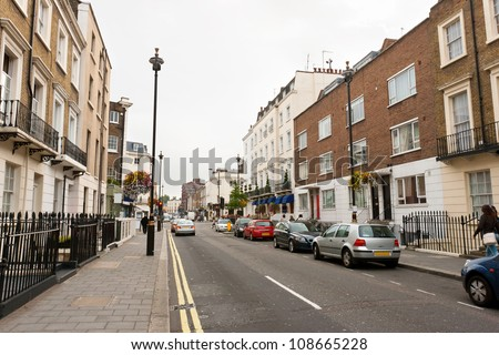Traditional town houses at Belgravia district in London, England - stock photo