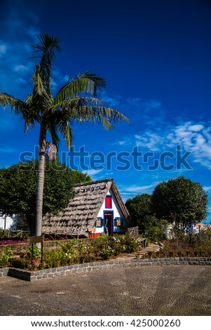 traditional triangular Madeira house thatched with straw - stock photo