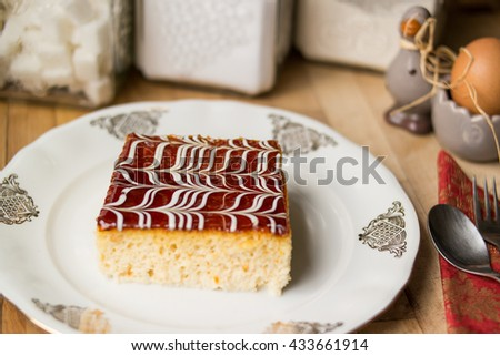 Traditional trilece dessert cake made with three milk on a wooden surface at kitchen with concept backround