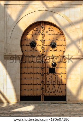 Traditional Tunisian door to a mosque - stock photo