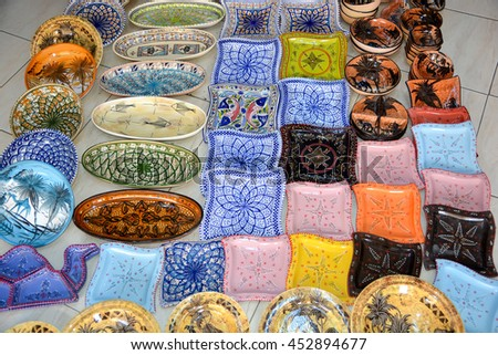 Traditional Tunisian national souvenir plates on the market of Sousse