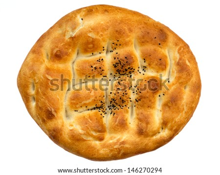 Traditional Turkish bread for holy month Ramadan isolated on white - stock photo