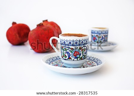 Traditional Turkish Coffee. Mocha with pomegranates. Isolated on white. - stock photo