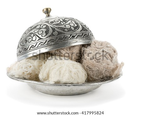 Traditional Turkish cotton candy called Pismaniye in vintage plate close up. - stock photo
