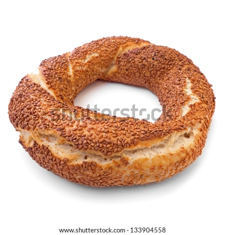 Traditional Turkish donut, called as Simit in Turkish,  isolated on white. - stock photo
