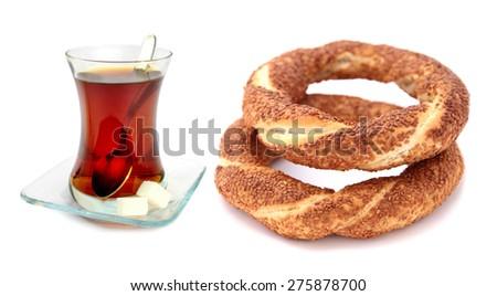 Traditional Turkish sesame bagel (simit) and Turkish tea - stock photo