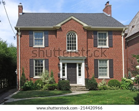 Traditional Two Story Brick House Shutters Stock Photo