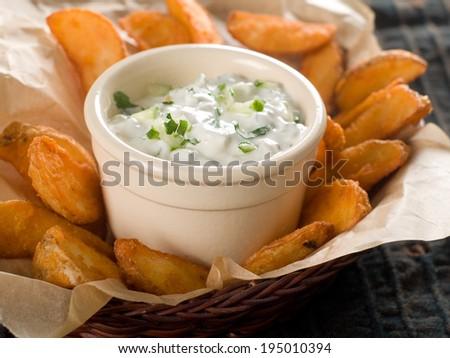 Traditional Tzatziki dip, made with yogurt or sour cream. Selective focus  - stock photo
