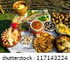 Traditional ukrainian food in assortment in festive decorating - stock photo
