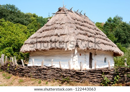 Traditional Ukrainian house with a thatched roof. Museum Pirogovo Kiev.