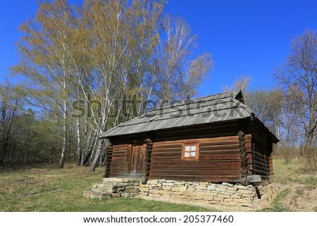 Traditional ukrainian wooden house in open-air museum Pirogovo. Kiev, Ukraine  - stock photo