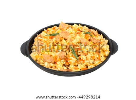 Traditional Uzbek pilaf in portioned frying pan on a white background