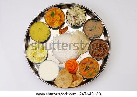 Traditional vegetarian indian thali lunch, meals, Complete nutritional indian food ,Typical south Indian Thali served in marriages - stock photo