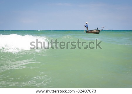 Traditional Vietnamese boat on the sea  in the basket shaped , Mui Ne, Vietnam - stock photo
