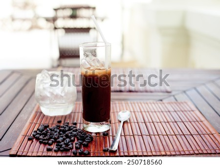 Traditional Vietnamese, Thai Ice coffee with coffee beans on a wooden background. Copy space. - stock photo