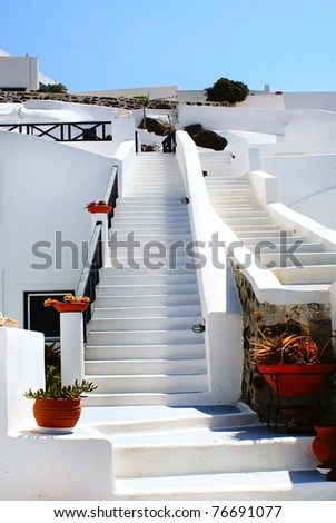 Traditional village of Oia at Santorini island in Greece - stock photo