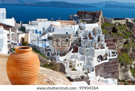 Traditional village of Oia at Santorini island in the Cyclades, Greece - stock photo