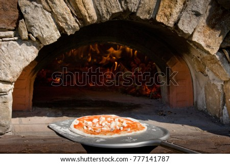 Traditional way baked wood fired oven Italian pizza bakery pizzeria